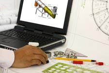 Man using laptop to design engineering materials