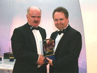 PHOTO: Mike McCulloch from Petrofac receiving the award from Lord Truscott, Parliamentary Under Secretary of State for Energy