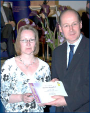 PHOTO: Karen Maughan receiving the award from John Swinney MSP, Cabinet Secretary for Finance and Sustainable Growth