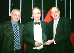 PHOTO: Lifetime Achievement award winner, Malcolm McArthur being presented with his award by Adam Ingram MSP, Minister for Children and Young People and Joe Wilson, SQA Business Manager