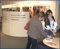 IMAGE: Visitors at the art exhibition