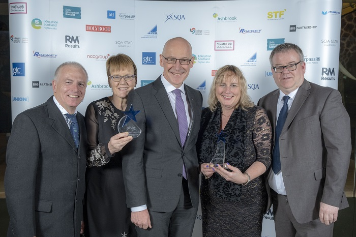 Dumfries and Galloway College and The Usual Place receiving award from John Swinney MSP