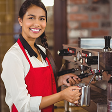 woman barista at coffee machine