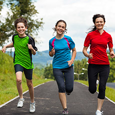 Photo of three young people running